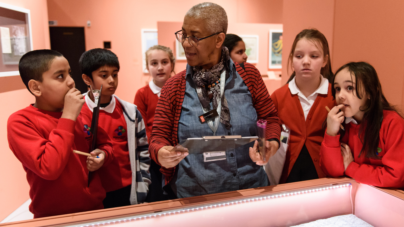 Thumbnail for Primary workshops - group of students with workshop leader in exhibition space