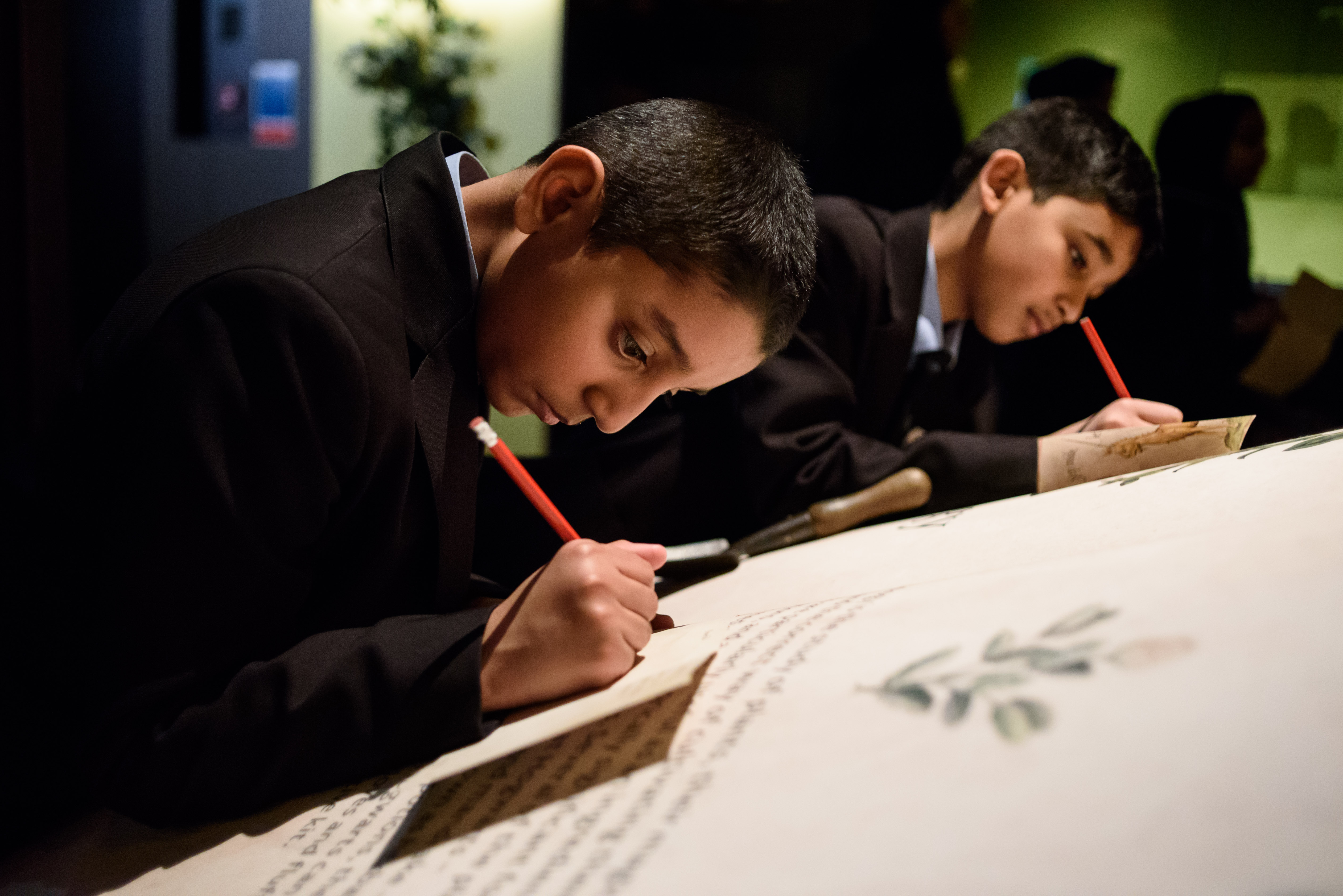 Secondary school students doing an activity in a British Library exhibition workshop