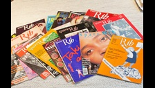A wide range of colourful magazine covers bearing the name 'Spare Rib' is fanned out