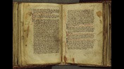 Open book manuscript. Two pages of text, Blue and red incipit letters