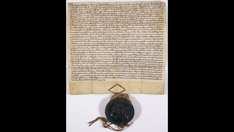 The Forest Charter of 1225. Manuscript with large seal attached the the bottom of the Charter