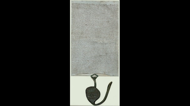 Manuscript of Magna Carta 1225 with a seal attached to the bottom of the page