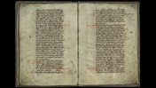 Open book image. Neatly written text with red ink notes in the margins