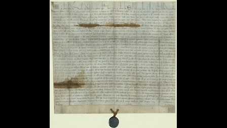 Manuscript page with wax seal attached to the bottom center of the manuscript. The Papal Bull Annulling Magna Carta