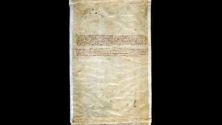 Manuscript Memorandum of the distribution of copies of Magna Carta. Black in on yellowing parchment