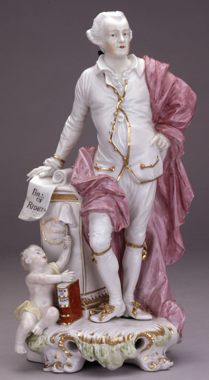 Porcelain figure of John Wilkes, holding the Bill of Rights and a scroll inscribed 'Magna Carta'