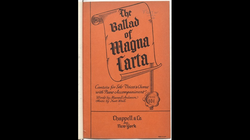 Front cover of the Score of 'The Ballad of Magna Carta'. Orange paper, black ink. The title is displayed in within a scroll representing magna carta