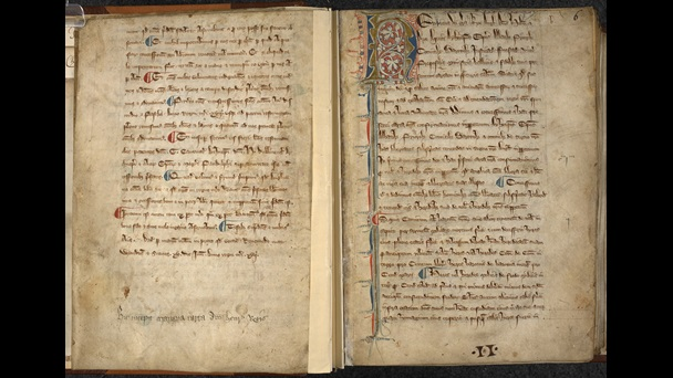 Open book manuscript. Red and Blue incipit lettering on the right hand page