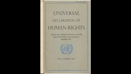 Front cover of the Universal Declaration of Human Rights. A blue logo decorates the front cover, it shows a world map sitting between laurel branches