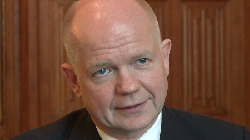 Film still of William Hague speaking to camera
