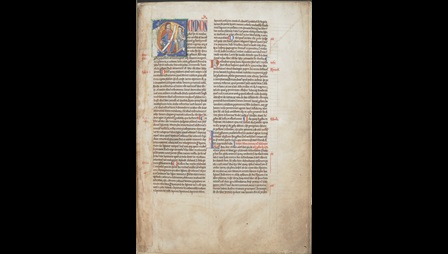 A page from a glossed copy of the Psalms, with a decorated initial containing an illustration of a scribe.