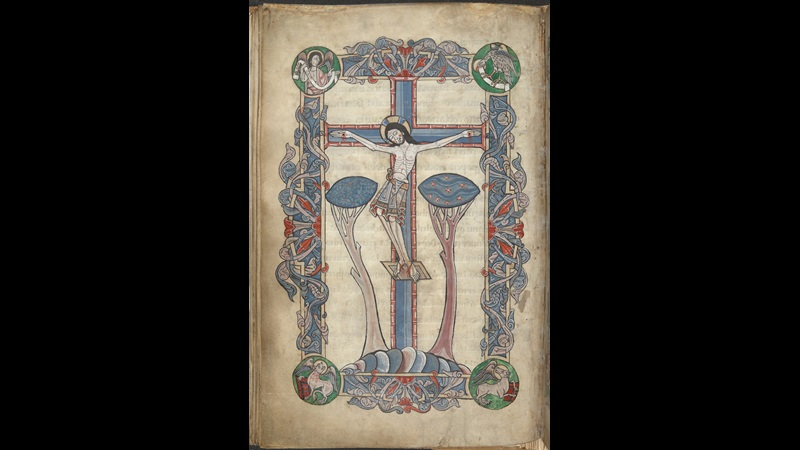 A full-page illustration of the Crucifixion from an illuminated 11th-century Psalter.