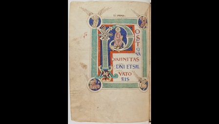 A page from the Lectionary of St-Maur-des-Fossés, showing a large decorated initial with a portrait of St Maurus and the symbols of the four Evangelists.