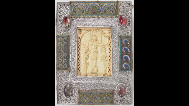 The jewelled lower cover of an 11th-century Gospel-book, featuring an ivory plaque that depicts the Crucifixion.