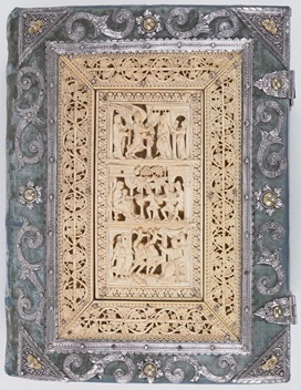 The upper cover of a 10th-century Gospel-book, featuring carved ivory plates that depict scenes from the early life of Christ.