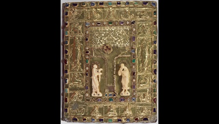 The gold and jewelled upper cover of the St Denis Missal, featuring a Crucifixion scene and two ivory figures of the Virgin and St John.