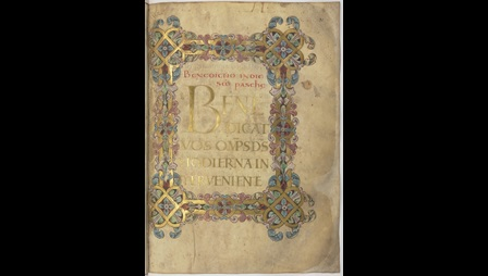 A page from the Winchester Benedictional featuring the first blessing for Easter, decorated with a border and letters written in gold.