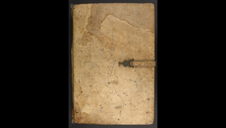 The upper cover of a glossed copy of the Book of Ezekial, featuring a leather strap with a clasp and pin.