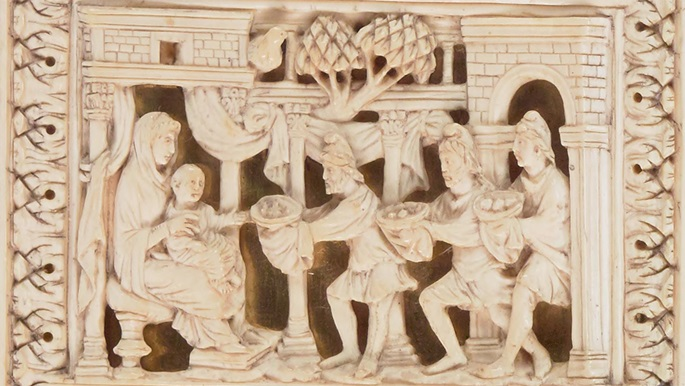 A depiction of the Adoration of the Magi, from the ivory binding of a 10th-century Gospel-book.