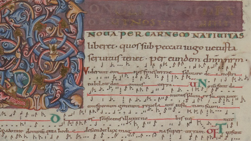 Chants for the mass of Christmas Day, with a large decorated initial and musical notation, from the St Denis Missal.