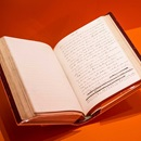 Photograph of a manuscript of Middlemarch against a bright orange background