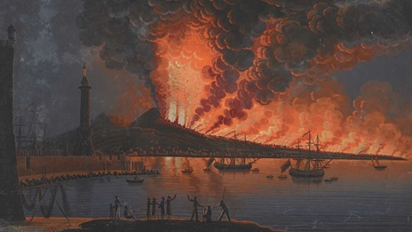 Summary: Nocturnal scene; a group of men watch the eruption of Mount Vesuvius from a pier next to a tower, with harbour and lighthouse at left, sailing ships and Bay of Naples at right and flames and clouds of smoke from the volcano covering the sky in the background; within painted frame with black edge, annotated with title in white ink below.  Summary: Titled 'Molo di Napoli, con terribile eruzione del Vesuvio mandata fuori la sera de 15 del mese di Giugno, 1794; ad ore 2 di notte.