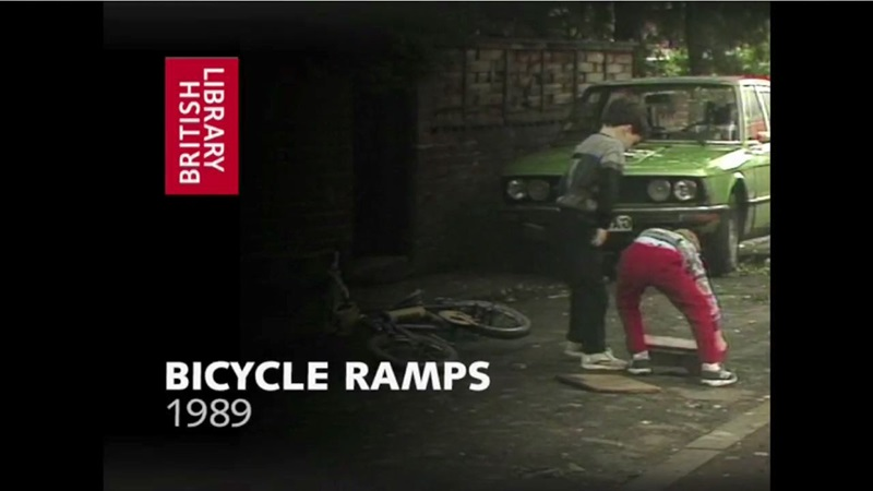 1980s film still of children playing with bikes and ramps