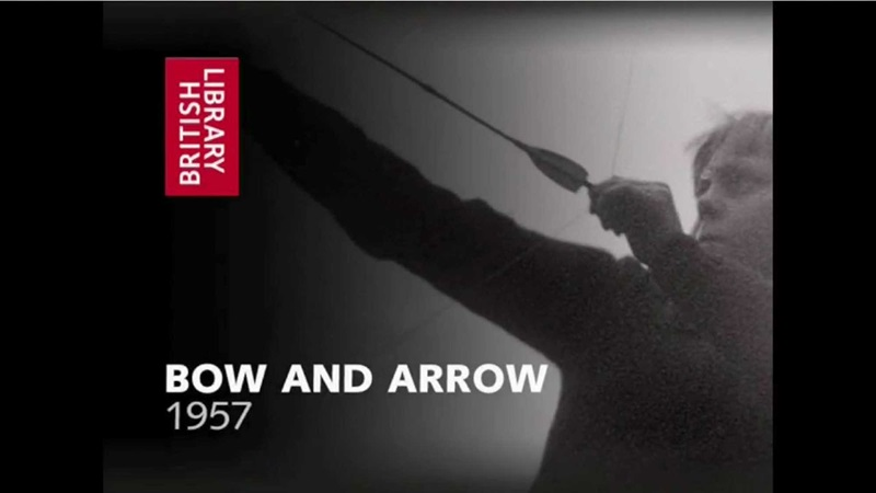 Historical film still of boy pulling a bow and arrow
