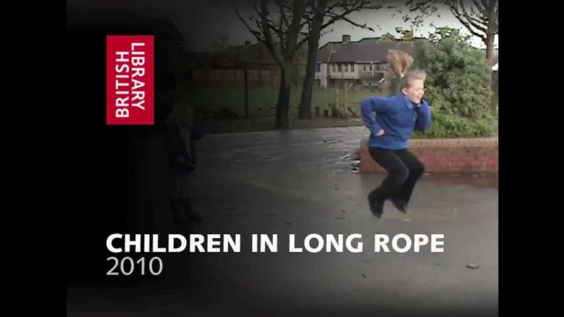 Contemporary film still of school girl jumping in air over skipping rope