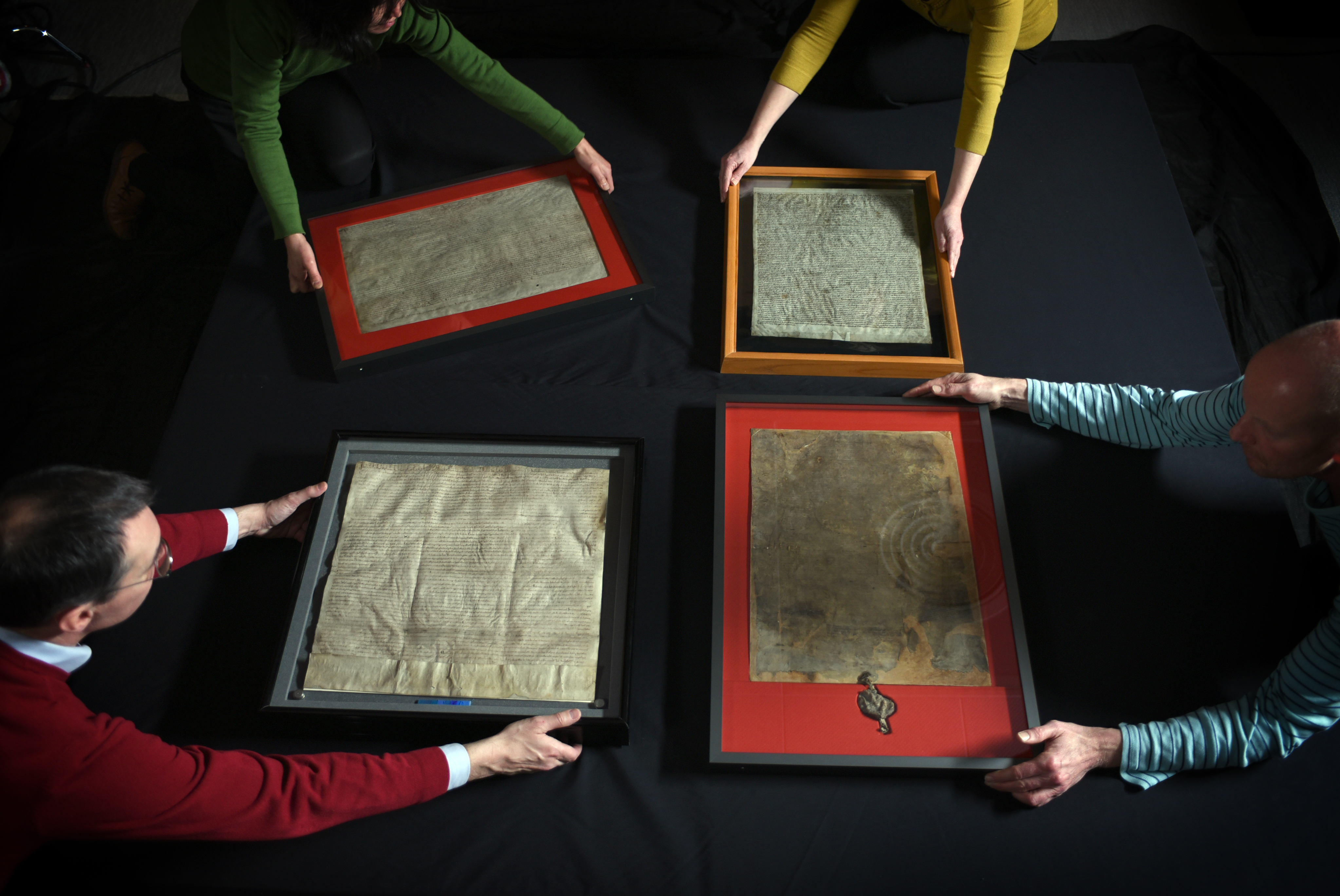 Magna Carta unification: the four original Magna Carta manuscripts being prepared for display at the British Library. Photographer credit Clare Kendall