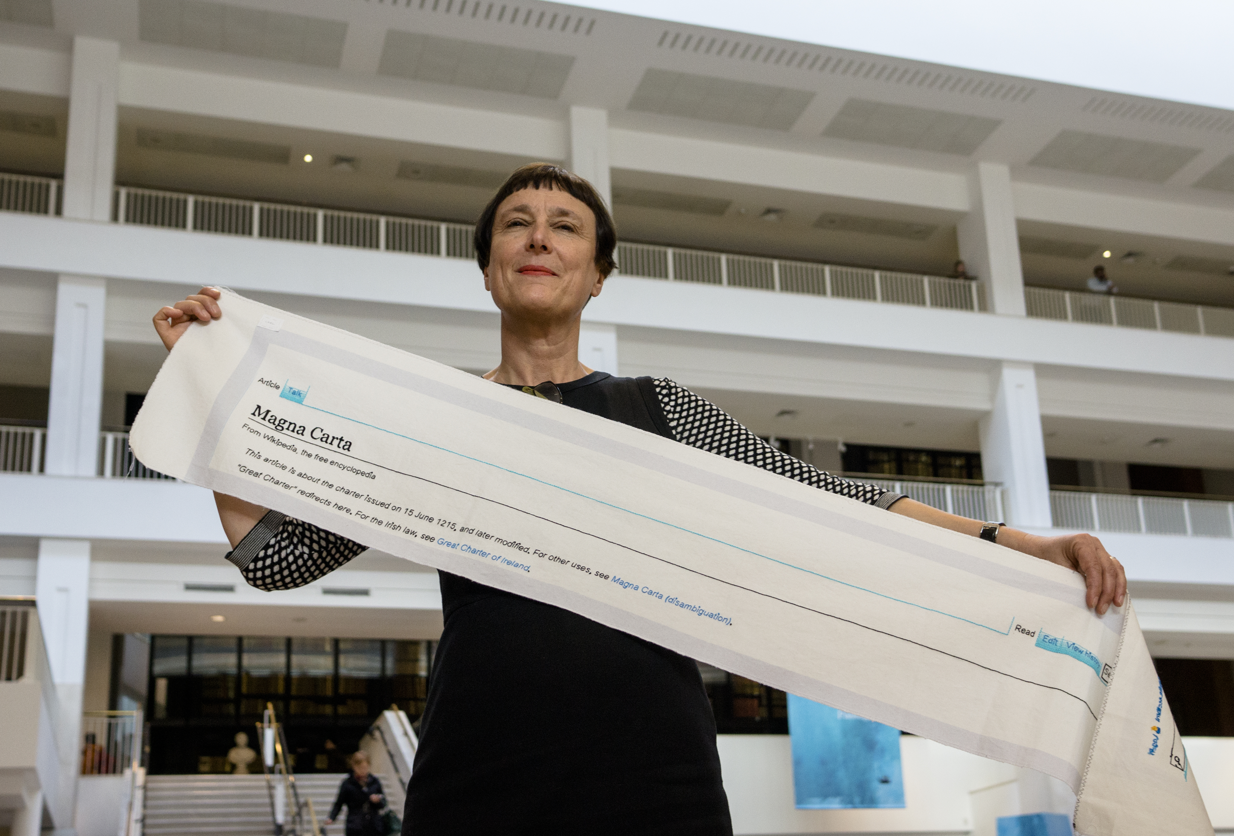 Cornelia Parker with a fragment of Magna Carta (An Embroidery) in the British Library (credit Tony Antoniou)