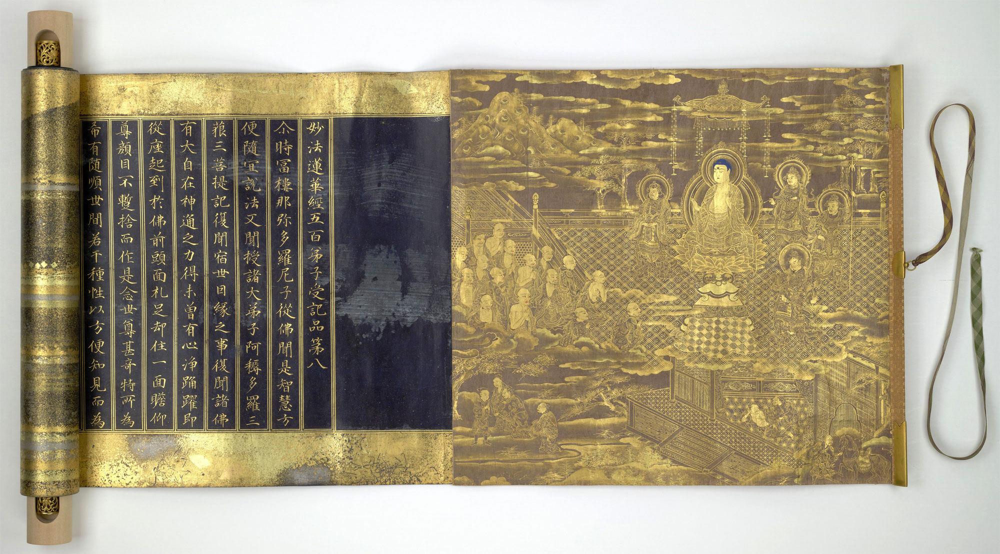 A copy of the Lotus Sūtra in a lavishly decorated scroll from Japan, dating from 1636. Gold gold and silver ink on indigo-dyed paper. Copyright: British Library Board