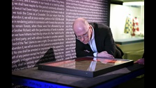Curator Julian Harrison examines a 1215 Magna Carta manuscript ahead of the opening of Magna Carta: Law, Liberty, Legacy at the British Library. Photography © Clare Kendall.