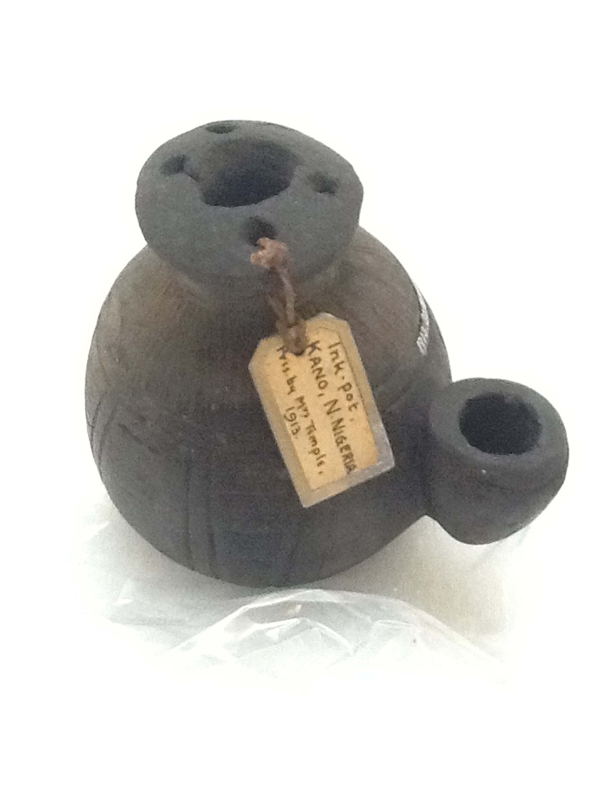 An ink pot from Nigeria on display in West Africa: Word, Symbol, Song. Courtesy of from Pitt Rivers Museum, University of Oxford.