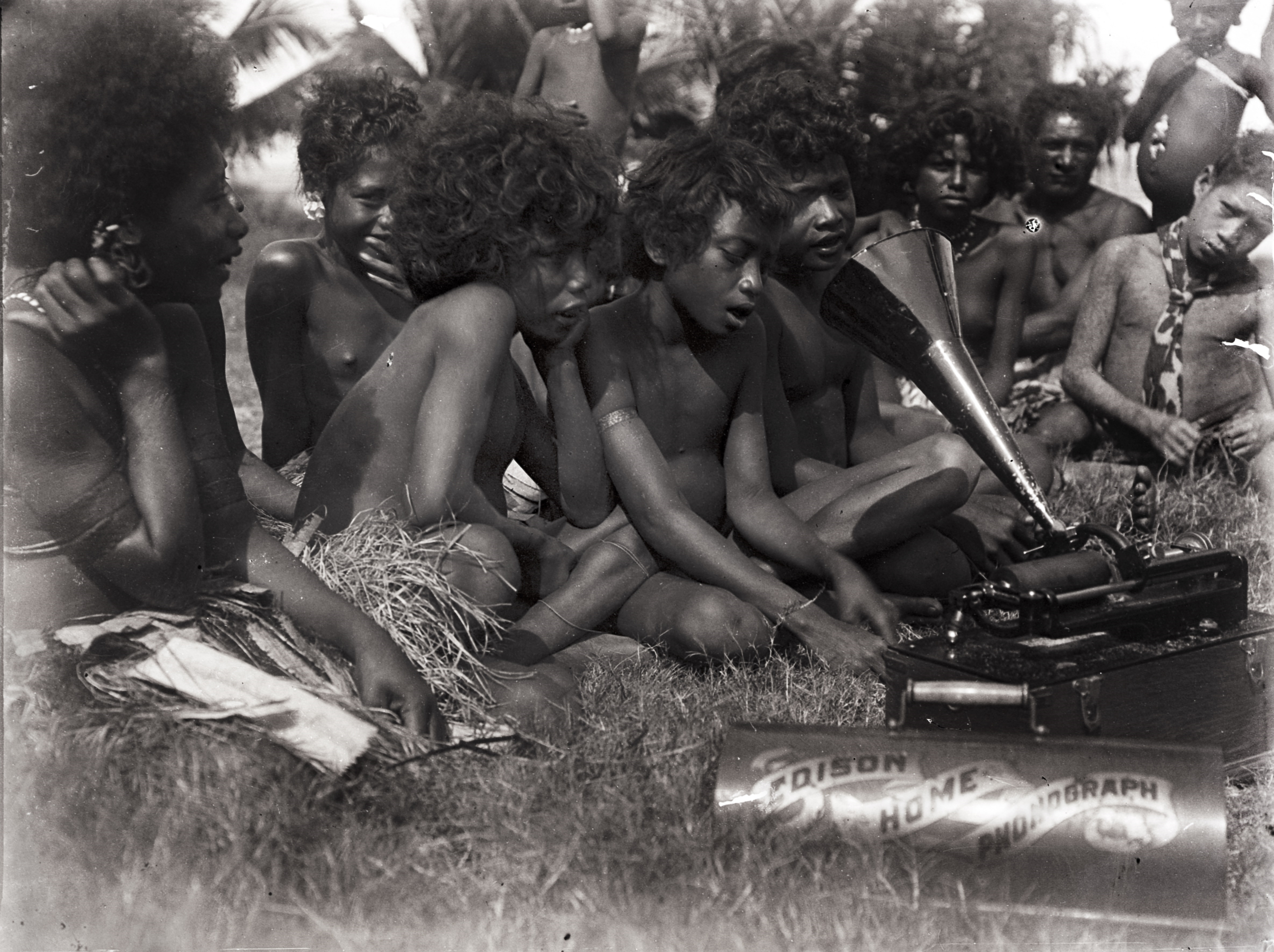 Close-up of girls singing into the phonograph. Hula, New Guinea. June 1898. [N.34988.ACH2] Image courtesy of the Cambridge Museum of Archaeology and Anthropology