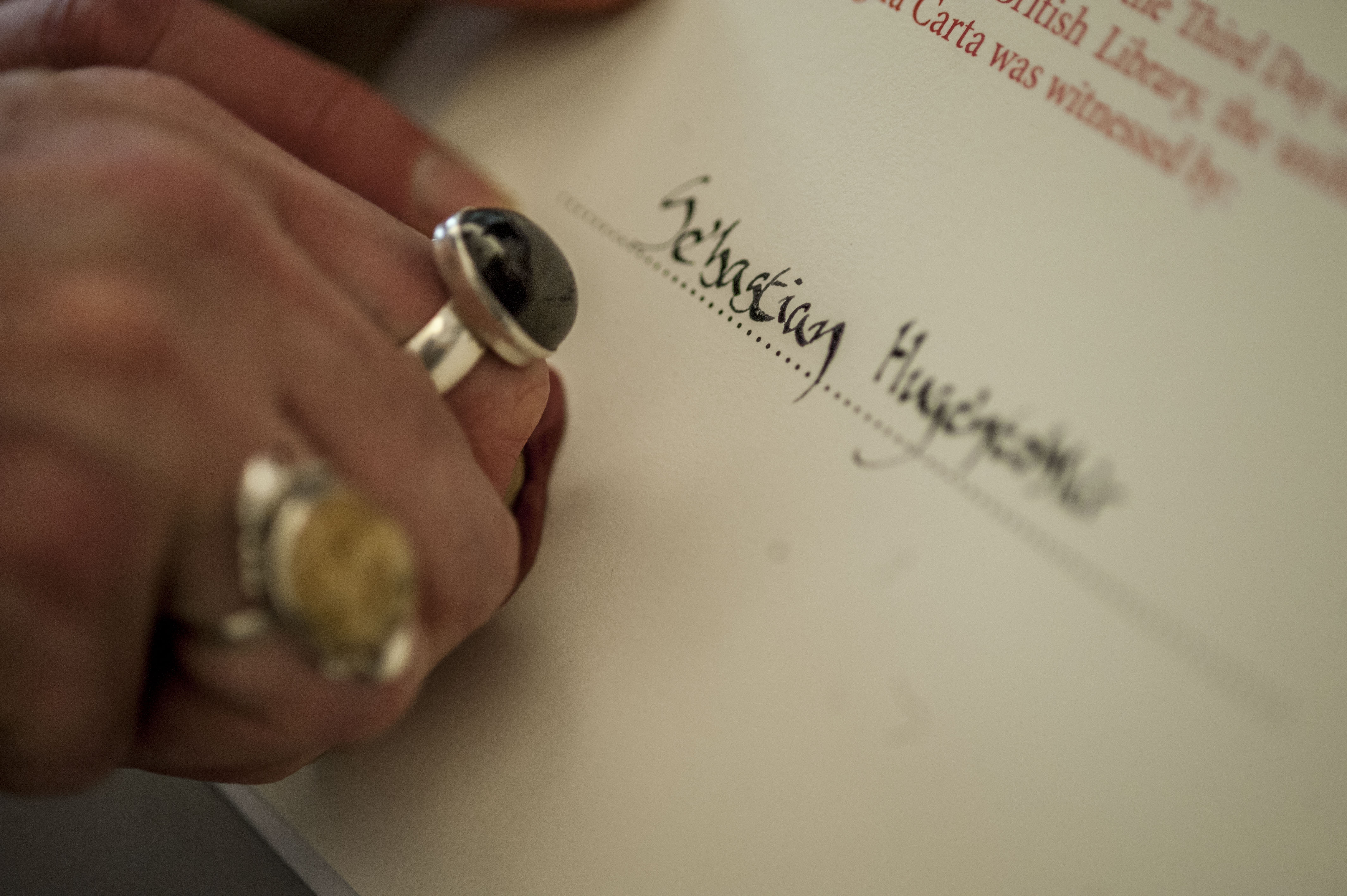 A certificate being sealed with wax at the Magna Carta unification at the British Library.