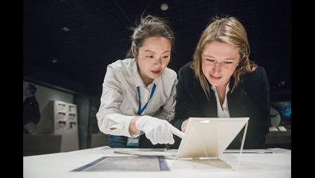 Alex Ault, Lead Curator to 'The British Library in China' project, checking objects condition with Liu Chang, exhibitions team leader at the National Library of China