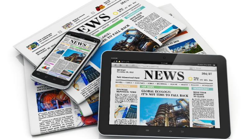 Newspapers, smartphone and tablet