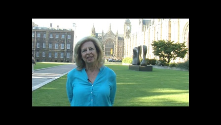 Film still from A democracy for women, showing Lesley Abdela standing outside parliament
