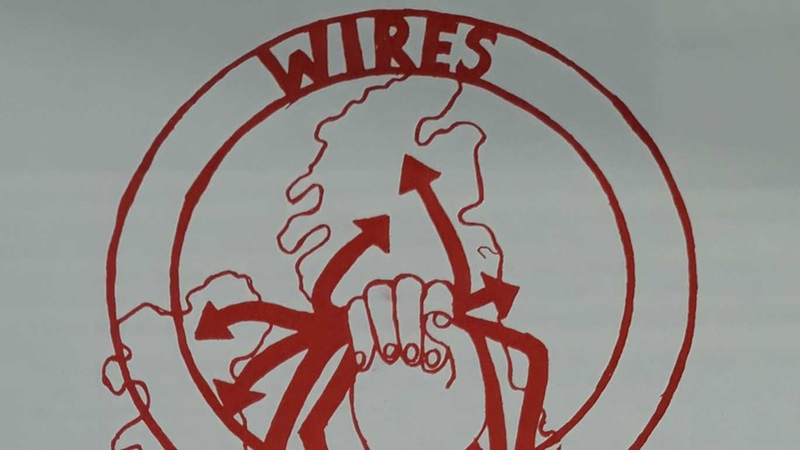 "A line drawing of a hand grasping arrows over a map of the British Isles within a female symbol labelled ""Wires""."