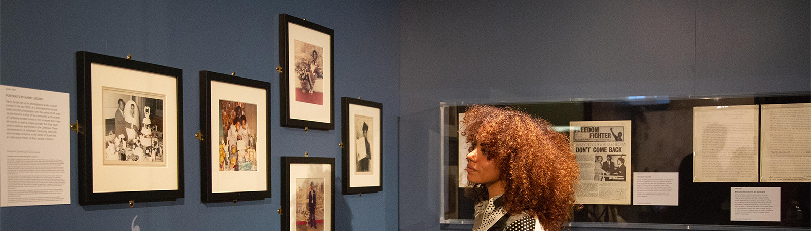 Woman looking at Windrush exhibition