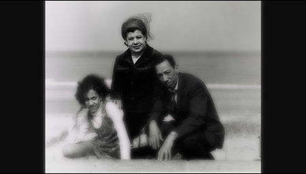 Photograph of Andrea Levy and her parents on a beach