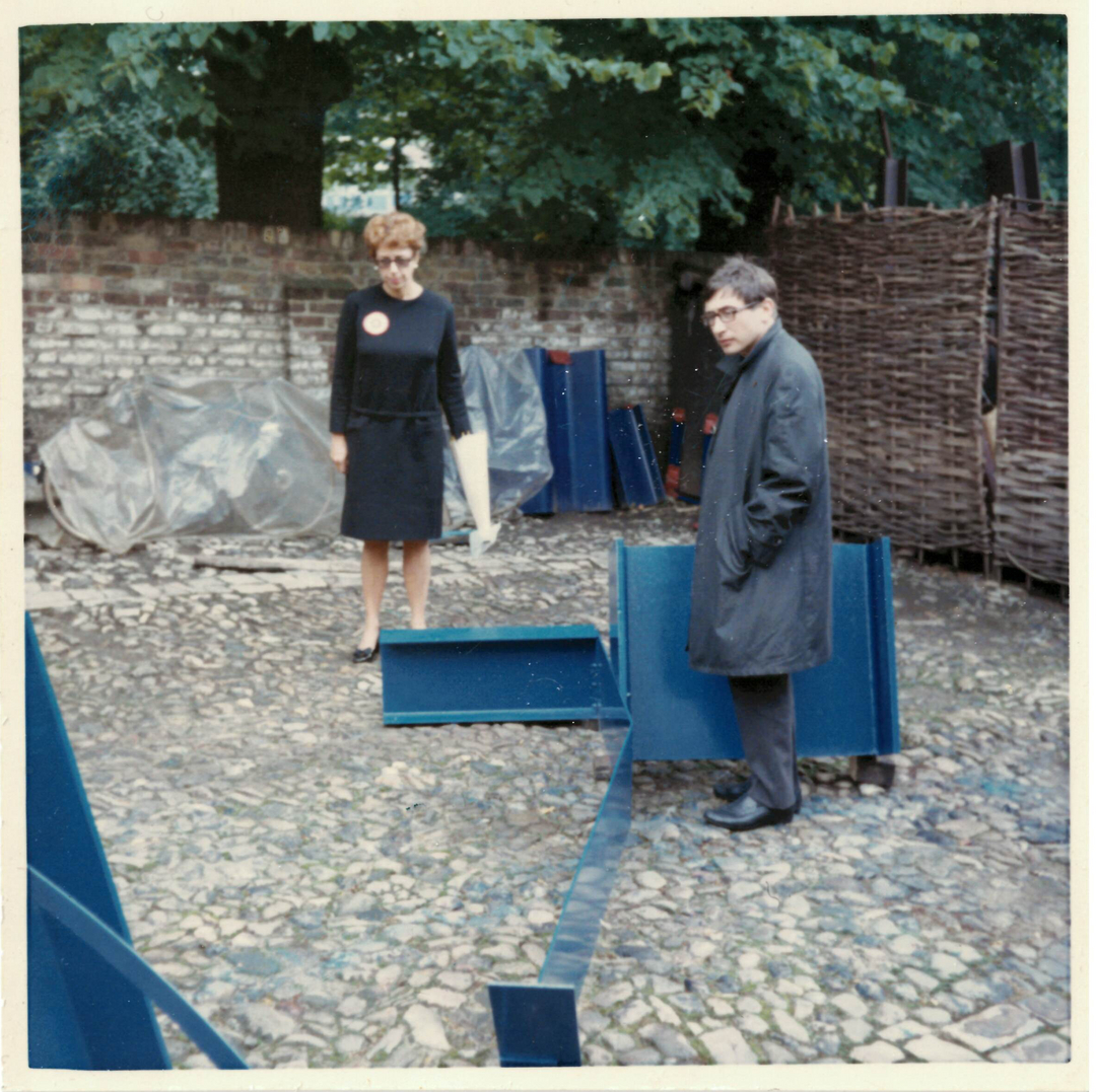 Kasmin at Anthony Caro's premises with some of his early steel sculptures, Frognal, London NW3, c. 1960.