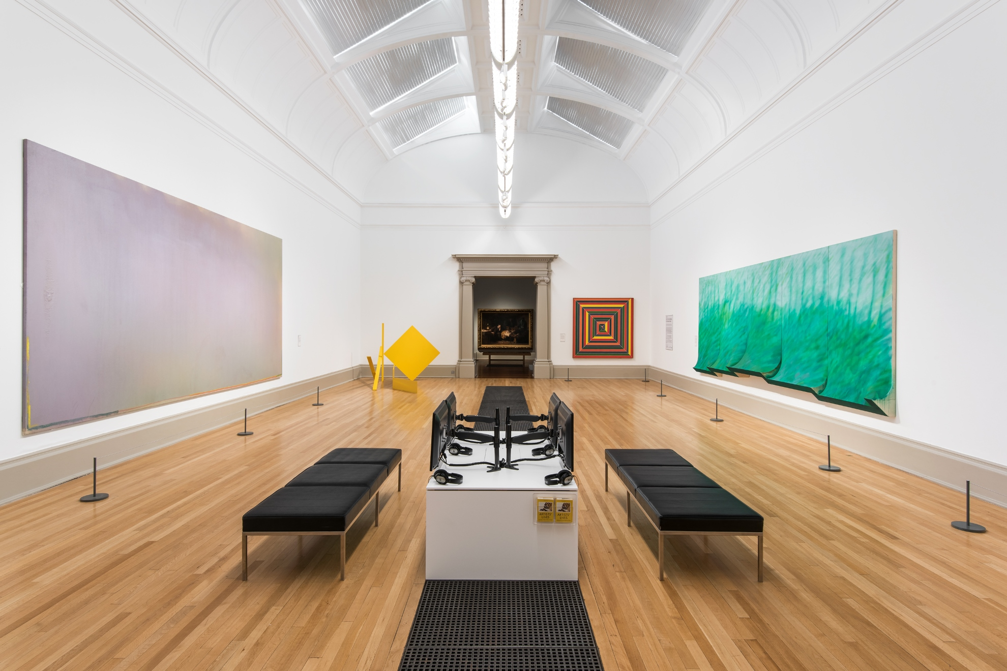 <i>Instant Loveland</i> by Jules Olitski (1968), <i>Yellow Swing</i> by Anthony Caro (1965), <i>Hyena Stomp</i> by Frank Stella (1962), and <i>Riverfall</i> by Richard Smith (1969) in the exhibition <i>Artists' Lives: Speaking of the Kasmin Gallery</i>, Tate Britain, December 2016 - April 2018. Photograph Joe Humphrys. Courtesy Tate.