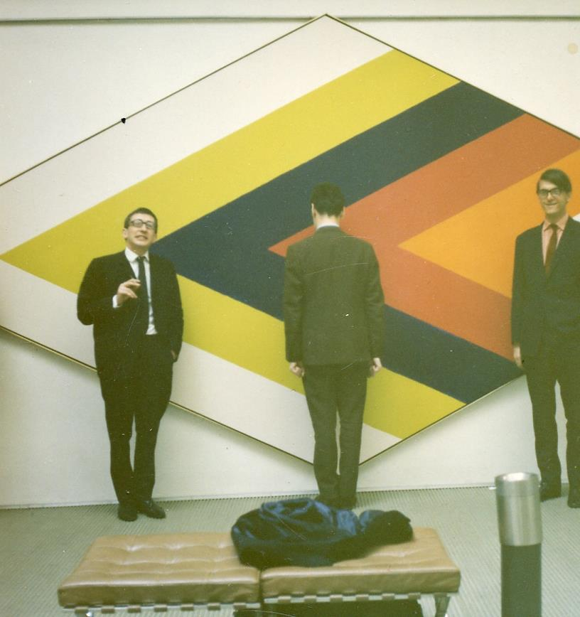 Kasmin (left), unknown figure, Sheridan Dufferin (right) with Kenneth Noland painting, 1968.