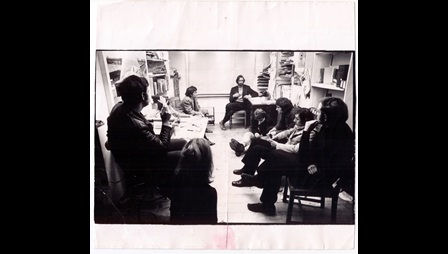 'Think Tank' at 22 Portland Road, London, c.1968. Clockwise: Barbara Steveni (foreground), David Hall, Garth Evans, Barry Flanagan, John Latham, Stuart Brisley, Maurice Agis, David Lamelas and Ian MacDonald Munro. Courtesy Barbara Steveni. Image not licensed for reuse.