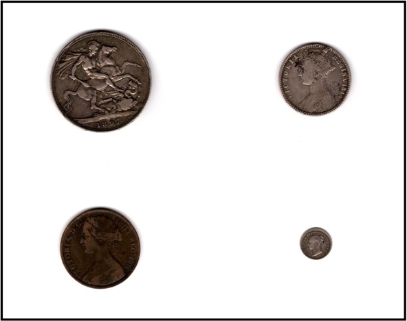 Coins, including the Godless florin and a Bun Head penny, saved by Norman Ackroyd from working in his father's shop. Courtesy Norman Ackroyd Collection. Image not licensed for reuse.