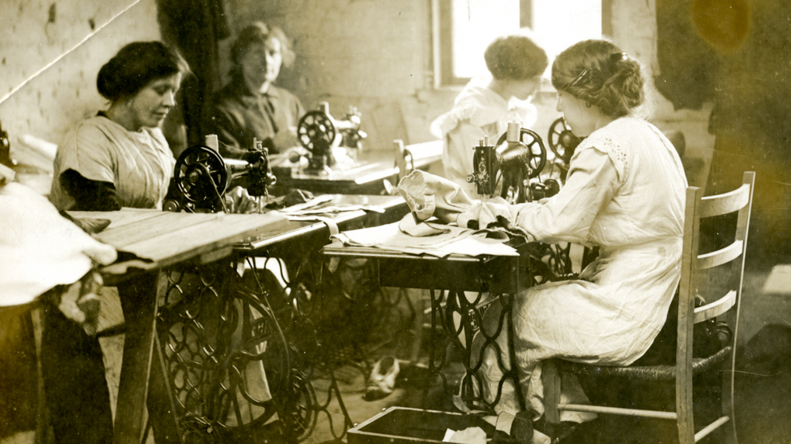 Working class women thumbnail - showing 4 women at work in a sewing factory
