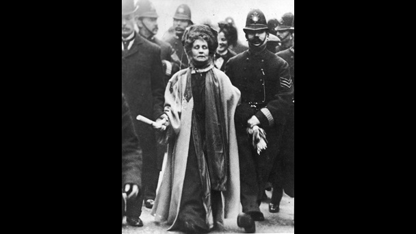 Emmeline Pankhurst flanked by numerous police officers