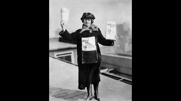 Photo of Kitty Marion selling issues of Birth Control Review on the streets of New York